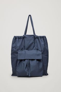 This large tote bag is made from a soft woven fabric with a protective cotton-twill lining. Designed with handles that can be gathered, it has a hidden inner zipped pocket and a lightly padded large front pocket. My Bags, Purses And Bags, Tote Bags For College, Soft Leather Handbags, Pink Leather, Leather Bags, Fabric Bags, Woven Fabric, Popular Handbags