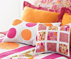 Squares and Circles Pillows Machine-appliqued circles, simple strips, and rectangles make these bright pillows a snap from start to finish.