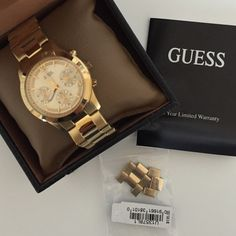 Guess Gold Watch Gently used Guess boyfriend gold watch, comes with original box, booklet, and tag. Links were taken off to fit my wrist, but can be easily reattached. I also still have a copy of the receipt if you're interested in seeing that for authenticity of purchase, with tax this watch was a little over $145, hence the original price. Please ask questions and place offers if interested  STYLE #: U13578L1 Guess Accessories Watches