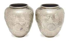 A PAIR OF CONTINENTAL SILVER BALUSTER VASES IN THE JAPONISTE TASTE,  RETAILER'S MARK OF TIFFANY, 20TH CENTURY,  Price realised  USD 4,375