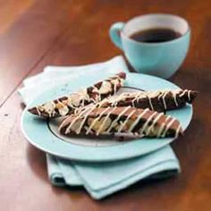"""Brownie Alpine Biscotti Recipe. """"I love visiting with friends over a pot of coffee, so I developed these crisp, chocolaty cookies to munch along with each cup,"""" comments Jeanie Williams of Minnetonka, Minnesota. Brownie mix makes them easy to stir up, and a white chocolate and almond topping adds a festive look."""