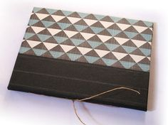 """IONA BINDING - Notebook with events and birthdays calendar that measures 4,44"""" x 5,62"""". Handmade with geometric print paper and gray stripes paper."""