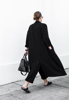 low bun, long black coat, cropped pants & birkenstock sandals #style #fashion