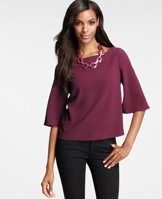 Crepe Bell Sleeve Top - Designed with a finely textured crepe, this bell-sleeved top flaunts a crisp, clean silhouette that provides the perfect canvas for the season's statement jewelry. Jewel neck. 3/4 sleeves with inner slits.