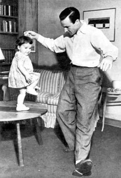 Gene Kelly teaches his daughter, Kerry, to dance.