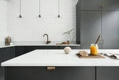 I like this grey kitchen with the copper handles and the ceiling high white metro tiles. The marble worktop and the pendant lights finish this look very nicely and the Thonet bar chairs add a soft touch to all the … Continue reading → Herringbone Subway Tile, White Subway Tile Backsplash, Light Grey Kitchens, Gray Kitchens, Kitchen Interior, Kitchen Design, Kitchen Furniture, Copper Handles, House Ideas