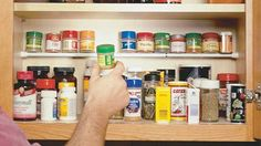 Do your spices need an organization makeover? Create a second shelf in your kitchen cabinet with a tension rod for those little spice jars. Genius!