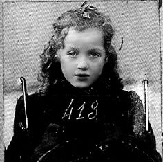 the saddest of all ... an identification photo of a beautiful child interred at Auschwitz-Birkenau concentration camp  ... stapled to a form and remembered only by a haunting face and a chilling, heartless number.