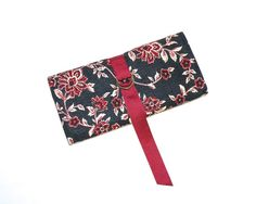 Jewelry Roll in a Red Floral Print on a Black and by bagsbystacey.etsy.com