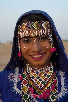 India | Portrait of a young Indian girl wearing beaded jewelry.  Thar Desert, Rajasthan | ©Steve Winter