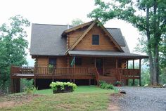 finally a log house that isn't a mansion :) love the deck but would like the deck on the side to be covered too.
