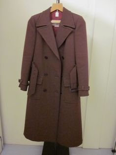 Yves Saint Laurent Coat - France 1965-69 Coat of brown synthetic fibre.