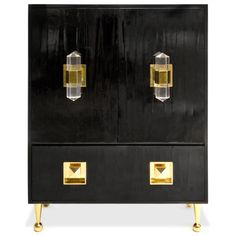 A commanding piece with fierce style and purposeful design. Understandably noted as the designers favourite piece, this versatile cabinet by Jonathan Adler works its magic as bar or armoire. It features boastful oversize brass and Lucite pulls and whimsic Lacquer Furniture, Modern Furniture, Furniture Storage, Oversized Furniture, Painted Furniture, Furniture Hardware, Furniture Ideas, Regency Furniture, Black Furniture