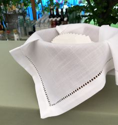 "Rochester Hemstitch Napkins are a fabulous addition to any event offering a classic and refined touch to the table setting. Hemstitch has the look and feel of linen. Available in napkins, runners, 60"" Squares and 90"" squares."
