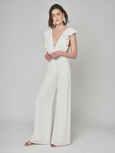 Alexandra Grecco Spring 2019 Collection silk crepe bodysuit with ruffle detail throughout bodice, paired with wide leg, silk crepe pants