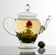 We could get some small fish bowls and use blooming teas as table decorations.