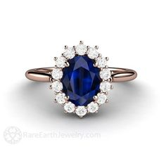 Many thanks to Julia for the tip on this one! Gorgeously feminine, a beautiful Blue Sapphire and diamond ring in your choice of 14K or 18K White, Yellow or Rose Gold and Platinum. At the center is