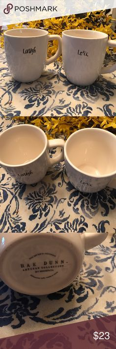 """Set of two highly collectible Rae Dunn mugs Perfect for gifting or to reward yourself every morning with a cup of tea or coffee, this set of two artisan collection mugs features """"Laugh"""" and """"Love"""" in Rae Dunn signature classic black script font. Rae Dunn Other"""