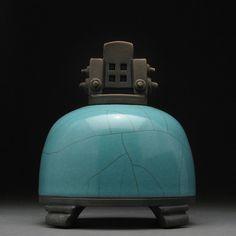 Ceramic Turquoise Raku fired jar with lid