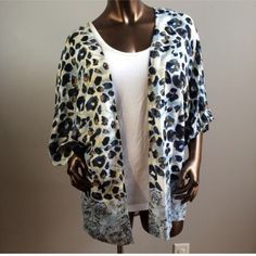 New Blue Cheetah Kimono Brand new with tags. Available in sizes small, medium and XL. Retail $39.99. Price firm. Tanzara  Sweaters