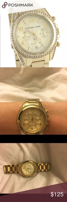Michael kors gold watch Gold watch, all crystals intact. worn few times, battery does not work. KORS Michael Kors Accessories Watches