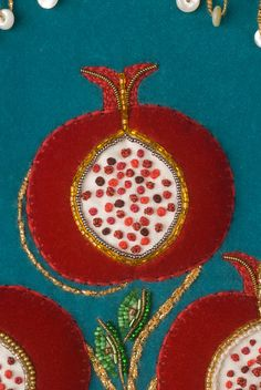 Dina's Pomegranate detail from a Torah Mantle