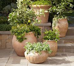 Decorating ideas for spring flowerpotsgreen plants front door inviting