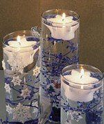 Snowflake Floating Candles in glass cylinders - table centerpieces Stick Centerpieces, Floating Candle Centerpieces, Wedding Centerpieces, Holiday Centerpieces, Holiday Decorations, Winter Wonderland Christmas, Winter Wonderland Wedding, Simple Wedding Table Decorations, Wedding Ideas