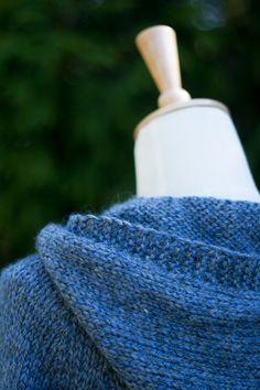 Hand knit hoodie.