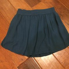 Urban outfitters skirt Turquoise skirt. Love it with a cropped sweater and booties. It's dark enough for winter with a pair of black tights but great for the spring with a tank and a light jacket. Urban Outfitters Skirts
