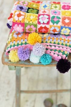Pom Poms on blankets and cushions!  Get a pom pom maker from http://www.clothkits.co.uk/maker-clover-pompom-bobble-maker-p-340.html