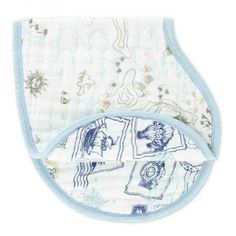 Warrior Finn Burpy Bib  Super soft & so absorbent, this organic Burpy Bib keeps you & your little one clean. The generously sized fabric drapes over baby's shoulders and snaps at the back for a breathable bib that's sure to catch sneaky side dribbles. It doubles as a no-slip burp cloth.