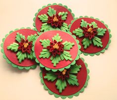 Poinsettia Gift Tags, Quilled, 6 Petal Flower with Quilled Poinsettia in Center, Green and Red, Christmas. $6.00, via Etsy.