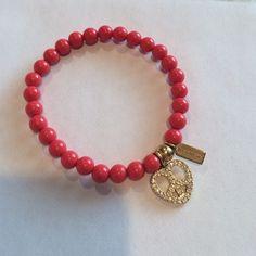 "Coach peace and love bracelet Scarlet beads gold charm with crystals.  ""Stretchy bracelet"" Jewelry Bracelets"