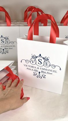 Monogram wedding welcome bags with red satin ribbon handles and custom navy blue print, Elegant personalized gift bags for wedding favor for guests. #welcomebags #weddingwelcomebags #giftbags #personalizedgifts #weddingfavor #weddingfavors #weddingbags #weddingfavorideas #weddingparty #favorbags #weddingwelcome #elegantwedding #weddingmonogram #redwedding #bluewedding #monogram