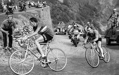 Fausto Coppi leads the way into a hairpin turn, Tour de France, 1952.