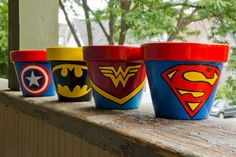 Superhero logo handpainted terracotta pots by SchumArt on Etsy