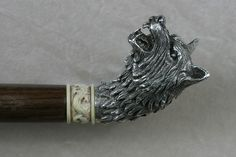 "Hero prop Wolf cane used in the 1st season. The head had to be very specific so the bruise left was distinctive. The cane was hand sculpted and cast in bronze with an antique silver plate. Shaft is black walnut with an imitation ivory band around the base. The band has a Chinese dragon hand carved into it and aged to look older. ""Copper"" Cineflix BBC America production,"