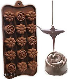 Baking Mould Flower Shape Silicone Chocolate Mould  Material: Silicone Pack: Pack of 1 Color: Multicolor (Random Color) Sizes: Mould Size: 9 in x 4.1 in x 0.4 in, Chocolate Cavity Size: 6.3 in x 3.1 in x 0.4 in Sizes Available: Free Size   Catalog Rating: ★4.1 (3003)  Catalog Name: Wonderful Candy & Chocolate Moulds CatalogID_934985 C137-SC1600 Code: 871-6141511-723
