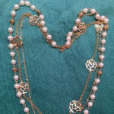 Long multi pearl and gold tone flowers chains. Clasp at back. Hangs about 12-14 inches. Lightweight. Perfect for young lady or for casual wear. Easy to match variety of colors and styles. New. Never worn. 2 sets in stock. Jewelry Necklaces