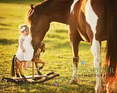 Horse and toddler on rocking horse.