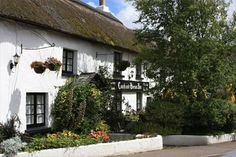 The Century thatched Coach and Horses Inn at Buckland Brewer, North Devon, England, UK. Local Pubs, Pubs And Restaurants, Most Haunted, Haunted Places, Devon And Cornwall, North Cornwall, North Devon, Best Beer, Natural Wonders