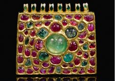 A Mughal gem-set and enamelled gold pendant, India, circa 18th century