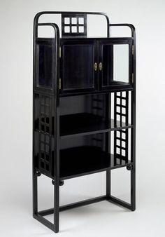 Josef Hoffmann, Vitrine (Model no. 600/9), made by Jacob & Josef Kohn,  c. 1905–08, ebonized beech, glass, and brass, the MFAH.
