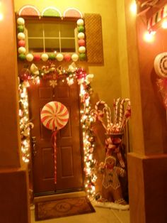 Outdoor Gingerbread house, My house decorated as a gingerbread house for the holidays, Our house decorated as a gingerbread house with gumballs, lemon wedges and Wafer cookies surrounding the windows and Candies over the garage and candy cane stick trim , Holidays Design