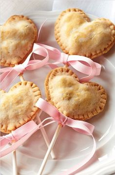 heart shaped cherry flavored pie pops with pink ribbons