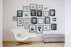 Black, white, and gray gallery wall with modern chair