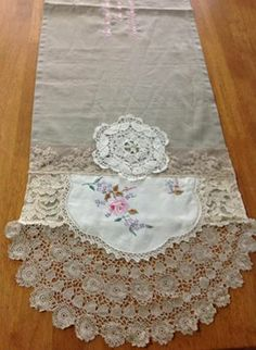 runner and 1/2 doiley at either end embellish with ribbon and embroidered smaller runner
