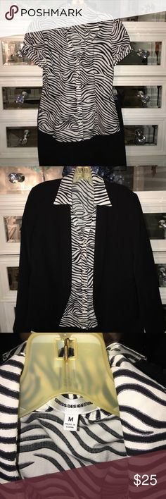 Express Design Studio size M top This is a super cute zebra print top with short sleeves and slightly puffy shoulders. No flaws! In perfect condition with no stains, missing buttons, tears nor holes. I love zebra print, but now I have too many 😊 Great work shirt with a skirt or black pants. Express Tops Button Down Shirts