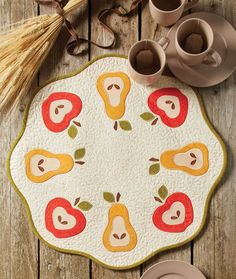 Pears and apples look great on an autumn table, but they're also fun for a spring or summer table. Make this table quilt pattern called Happy Harvest, by Patrick Lose, featuring appliquéd fruit! Get the quilt kit while supplies last.